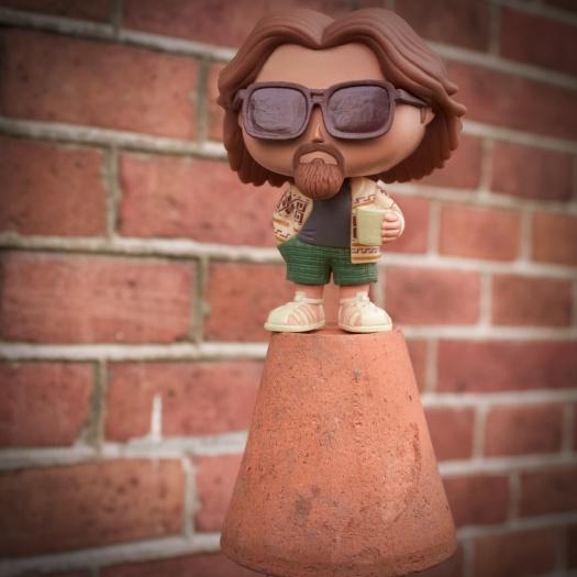 """Pop figure of Jeff """"The Dude"""" Lebowski on a miniature terra cotta pot."""