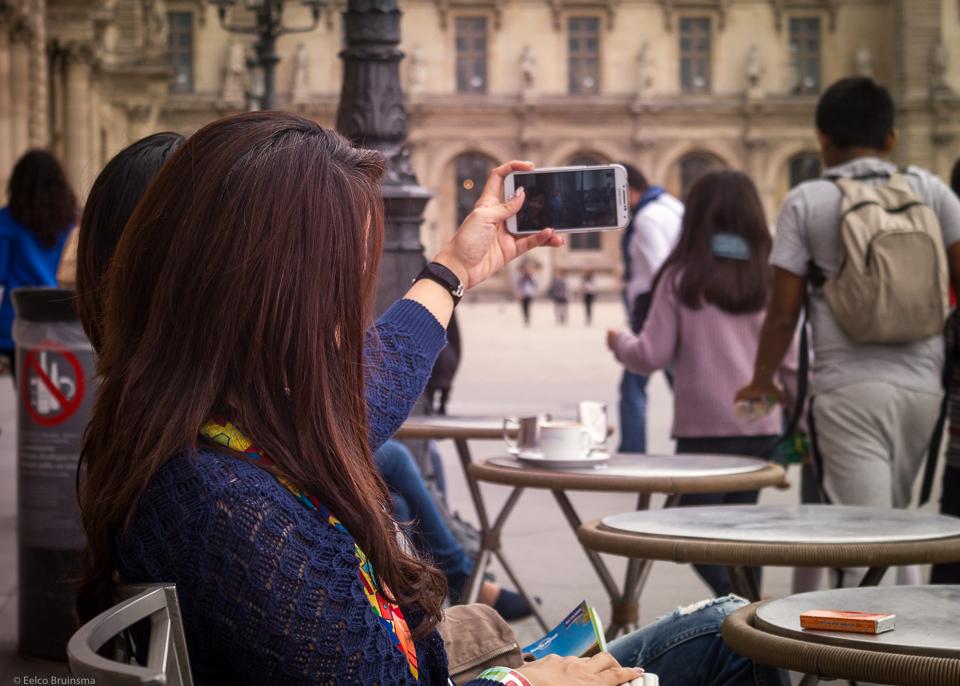 Woman taking selfie on terrace in Paris