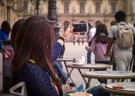 Woman taking selfie on terrace in Paris